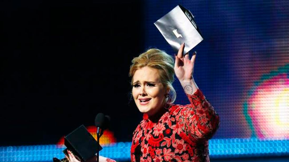 """Adele holds the Grammy for Best Pop Solo Performance for her song """"Set Fire To The Rain """" at the 55th annual Grammy Awards in Los Angeles"""