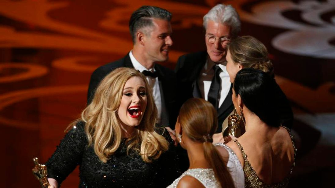 Singer Adele reacts after accepting the award for best original song at the 85th Academy Awards in Hollywood