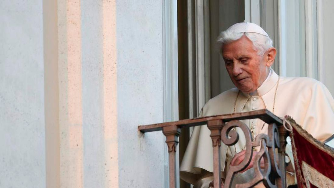 Pope Benedict XVI leaves as he appears for the last time at the balcony of his summer residence in Castelgandolfo