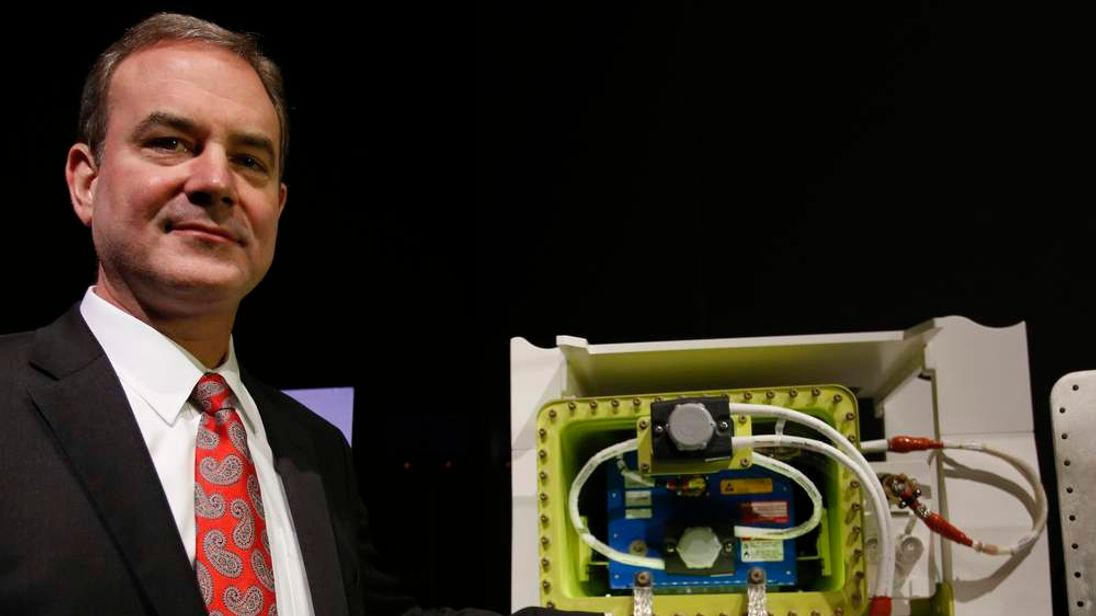 Boeing vice president and 787 Dreamliner chief production engineer Sinnett poses with model of Boeing's 787 Battery Design Improvements after a news conference in Tokyo