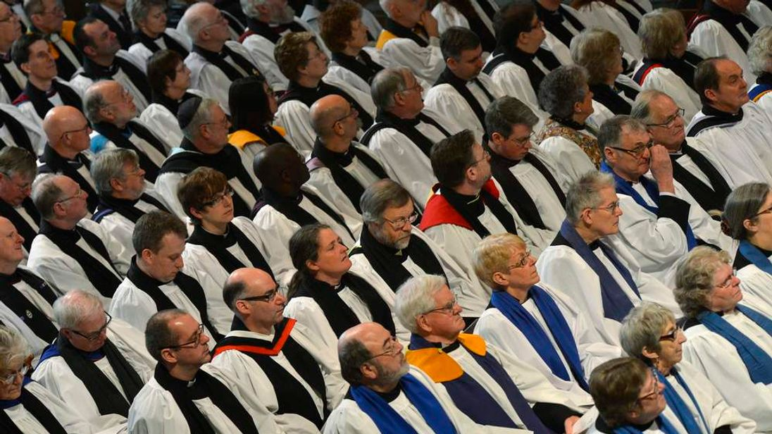 Clergy members listen during the enthronement ceremony for the new Archbishop of Canterbury, Justin Welby, at Canterbury Cathedral at Canterbury, southern England