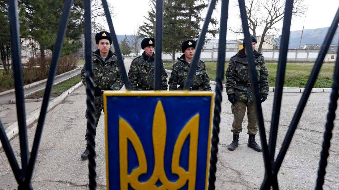 Ukrainian servicemen stand guard outside a military unit in Perevalnoye outside Simferopol
