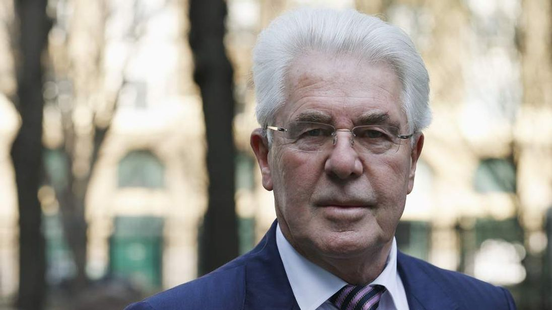 Max Clifford arrives for trial at Southwark Crown Court. File pic