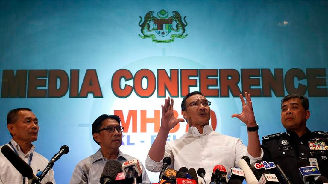 Malaysia's Transport Minister Hishammuddin Hussein speaks during a news conference about the missing Malaysia Airlines flight MH370, at Kuala Lumpur International Airport.