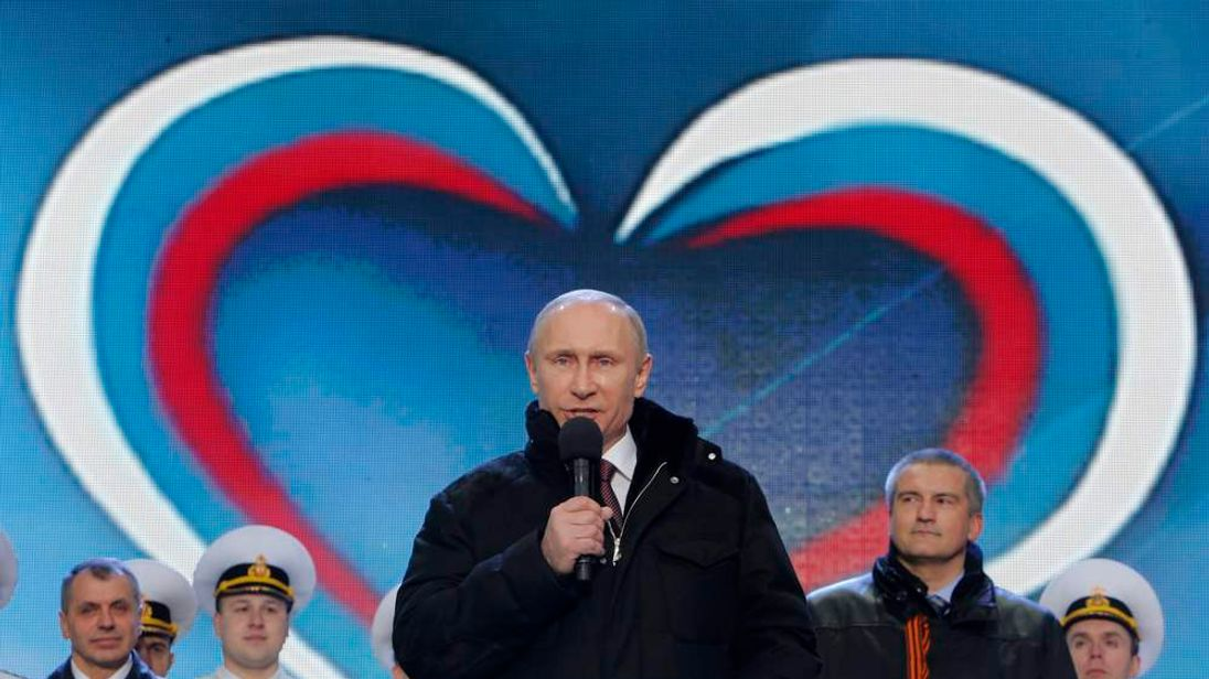 """Russia's President Putin addresses audience during a rally and concert called """"We are together"""" to support annexation of Ukraine's Crimea to Russia, at Red Square in central Moscow"""