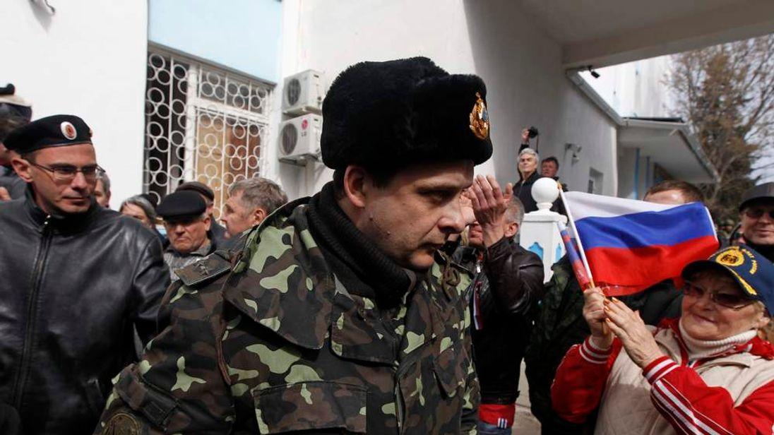 A Ukrainian serviceman leaves the naval headquarters in Sevastopol