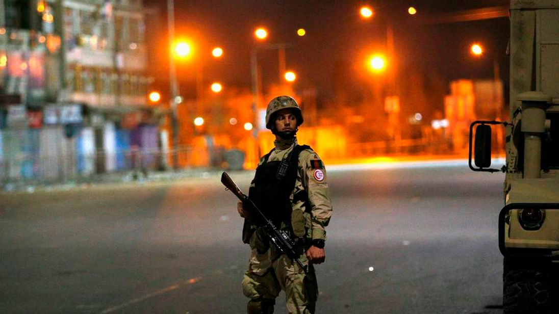 An Afghan security personnel keeps watch near the Serena hotel, during an attack in Kabul