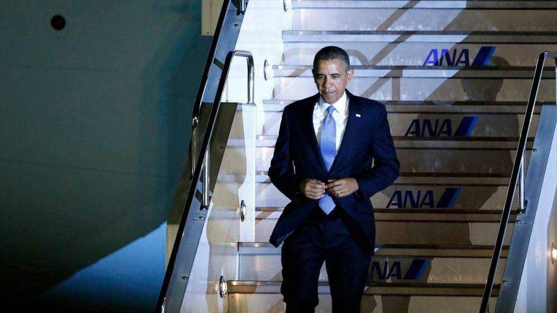 U.S. President Obama walks down the steps of Air Force One as he arrives at Haneda International Airport in Tokyo