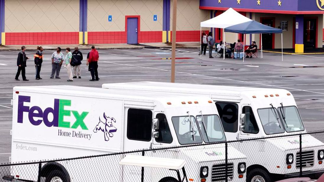 Fed-Ex employees and friends wait at a staging area at a skating rink after a shooting at a FedEX Corp facility at an airport in Kennesaw