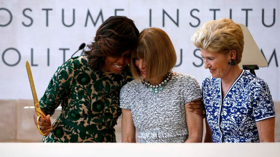US First Lady Obama embraces U.S. Vogue fashion editor AmnnWintour at a ceremony to open the Anna Wintour Costume Center in New York.