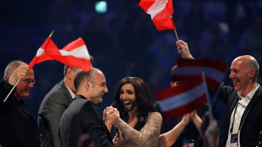 Conchita Wurst representing Austria reacts as preliminary resulsts are announced during grand final of the 59th Eurovision Song Contest in Copenhagen