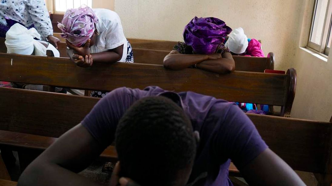 Churchgoers pray for the release of secondary school girls abducted from the remote village of Chibok, at an Evangelical Church of West Africa church in Abuja.