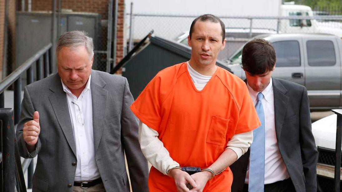 James Everett Dutschke flanked by U.S. Marshals arrives for a sentencing hearing at the United State Federal Building in Aberdeen