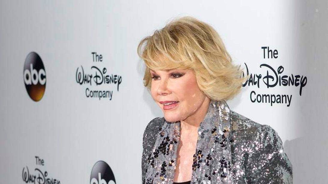 "Comedian Joan Rivers arrives for ""A Celebration of Barbara Walters Cocktail Reception"" in New York"