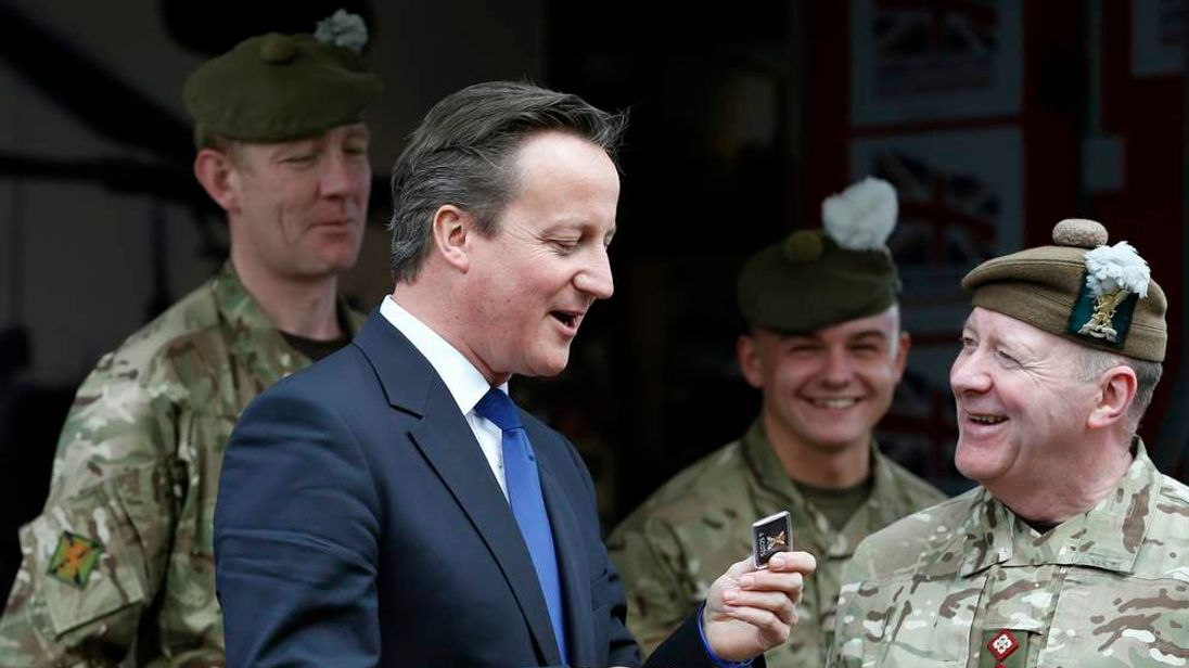 Britain's Prime Minister speaks with soldiers during his visit to the Walcheren Barracks in Glasgow, Scotland