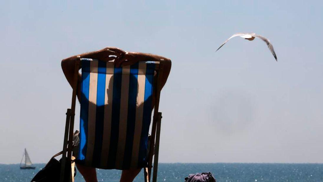 Sunbather on Brighton beach