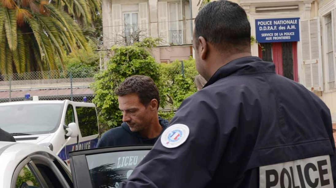 French Police escort convicted rogue trader Jerome Kerviel during a transfer from a commissariat in Menton