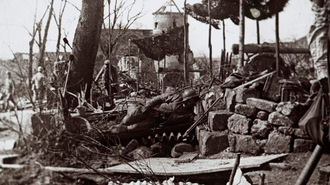 An undated archive picture shows a French soldier resting on the Maubeuge road at Ferriere la Grande, Northern France
