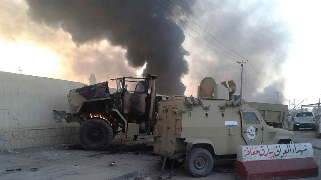 Damaged vehicles belonging to Iraqi security forces are seen during clashes between Iraqi security forces and al Qaeda-linked Islamic State in Iraq and the Levant (ISIL) in the northern Iraq city of Mosul