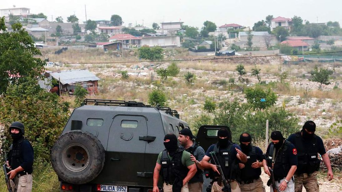 Members of the Albanian special police prepare to search a house in Lazarat