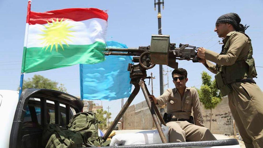 A military convoy drives towards Kirkuk, to reinforce Kurdish Peshmerga troops in Kirkuk