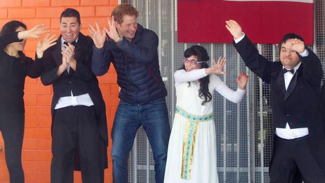 Britain's Prince Harry participates in a performance during his visit to a school for children with disabilities in Santiago