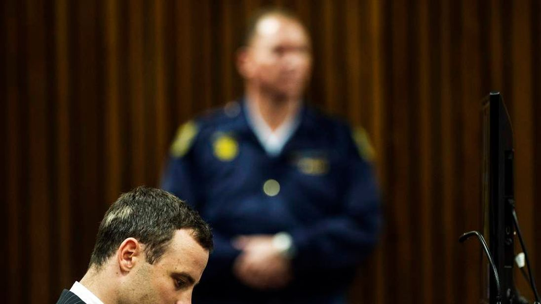 South African Olympic and Paralympic sprinter Oscar Pistorius sits in the dock during his trial in the North Gauteng High Court in Pretoria