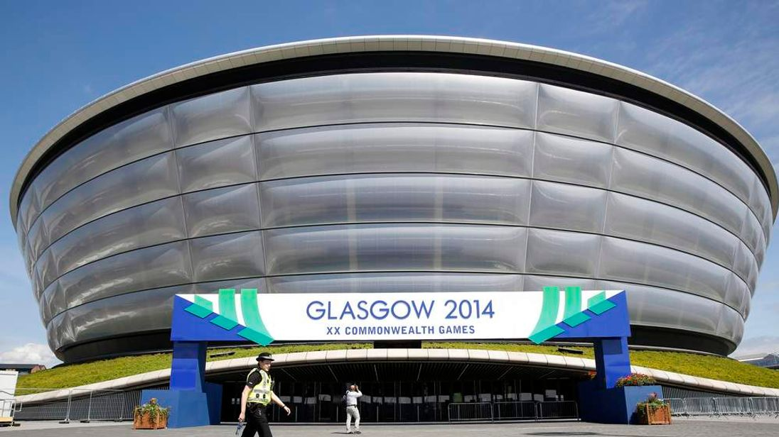 A police officer patrols inside the security perimeter in preparation for the Commonwealth Games in Glasgow