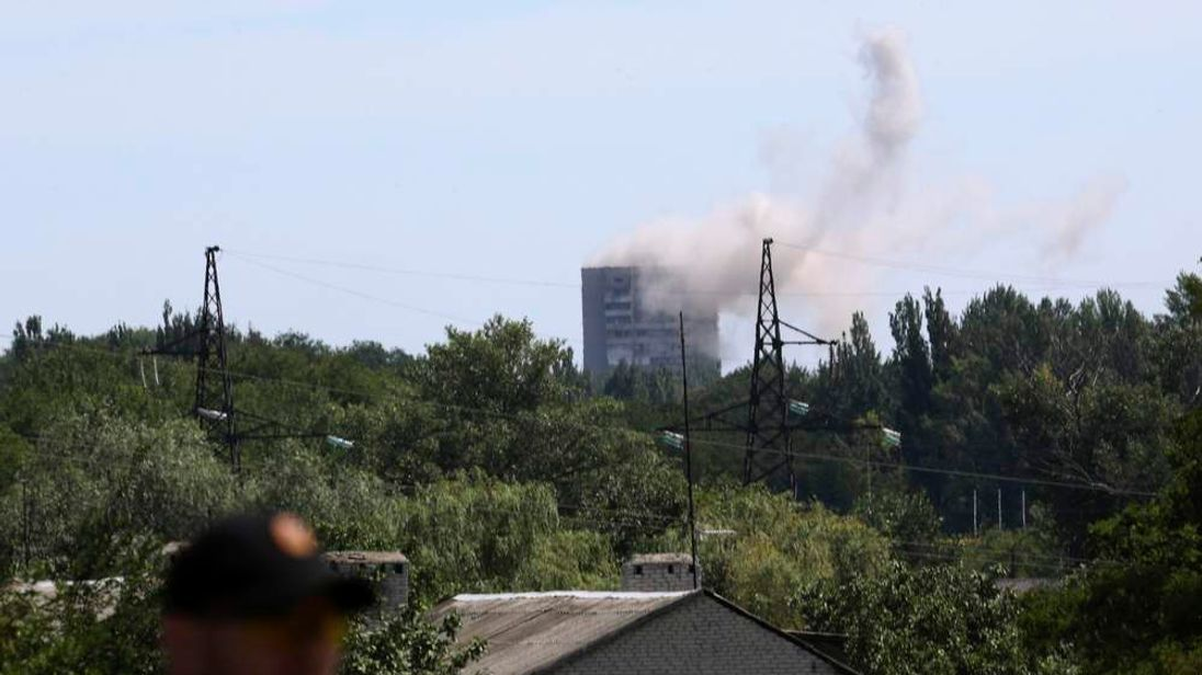 Smoke rises above a damaged multi-storey block of flats following what locals say was shelling by Ukrainian forces in Shakhtarsk, Donetsk region