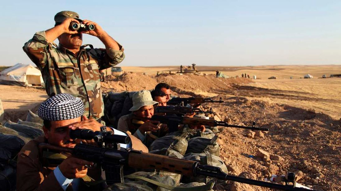 Kurdish peshmerga troops keep guard during an intensive security deployment against Islamic State militants on the frontline in Khazer