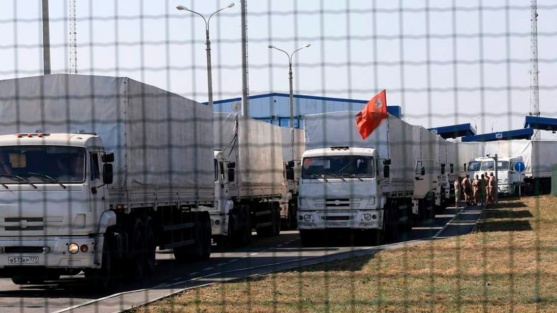 """Trucks from a convoy that delivered humanitarian aid for Ukraine are seen inside border crossing point """"Donetsk"""" in Russia's Rostov Region"""