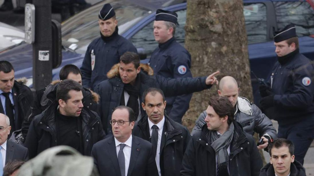 French President Francois Hollande arrives after a shooting at the Paris offices of Charlie Hebdo, a satirical newspaper