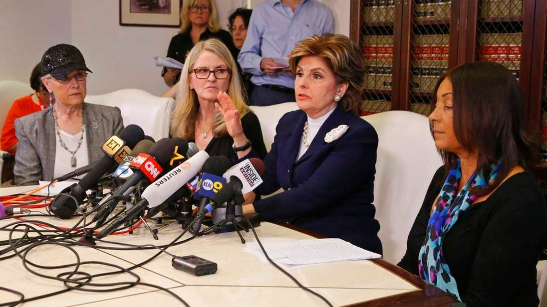 Three women who allege they were sexually assaulted by comedian Bill Cosby sit with lawyer at a news conference in Los Angeles