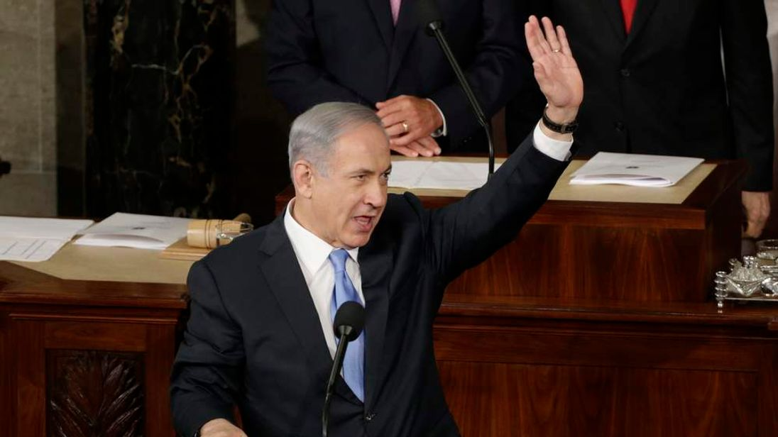 Israeli Prime Minister Netanyahu acknowledges applause during address to joint meeting of Congress on Capitol Hill in Washington