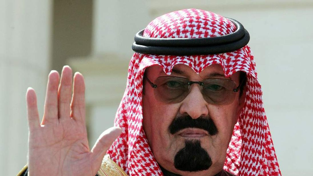 Crown Prince Abdullah waves as he arrives to open a conference in Riyadh, Feburary 5, 2005