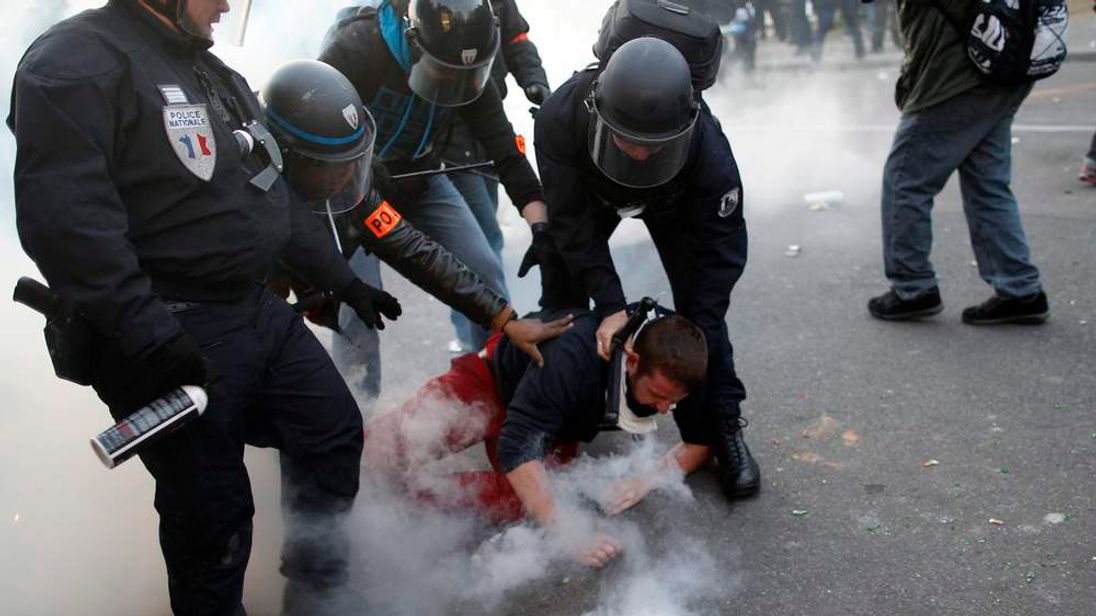 """French police detain a youth during incidents at the end of a protest march called, """"La Manif pour Tous"""" (Demonstration for All) against France's legalisation of same-sex marriage, in Paris"""