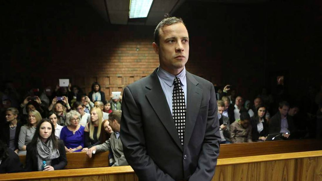 Oscar Pistorius enters the dock before court proceedings start at the Pretoria Magistrates court.