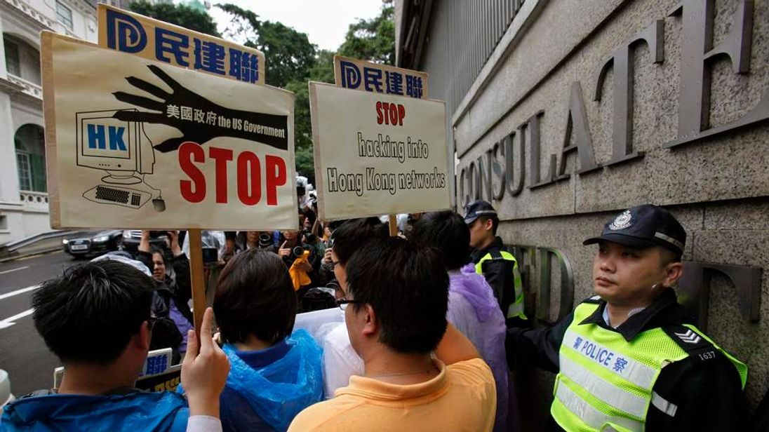 Protesters rally against the US government hacking into Hong Kong computers, in Hong Kong