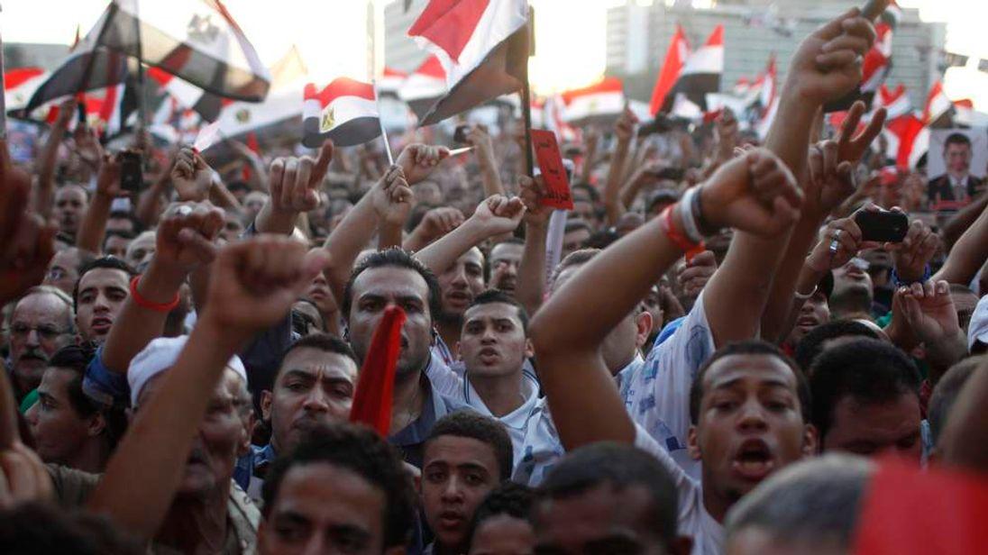 Anti-Mursi protesters chant in Tahrir Square in Cairo