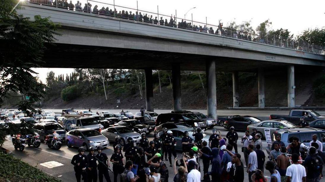 A crowd of demonstrators block traffic on the Interstate 10 freeway while protesting the acquittal of George Zimmerman in the Trayvon Martin trial, in Los Angeles