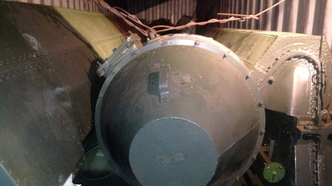 """A long, green missile-shaped object is seen inside the North Korean flagged ship """"Chong Chon Gang"""" docked at the Manzanillo Container Terminal in Colon City"""