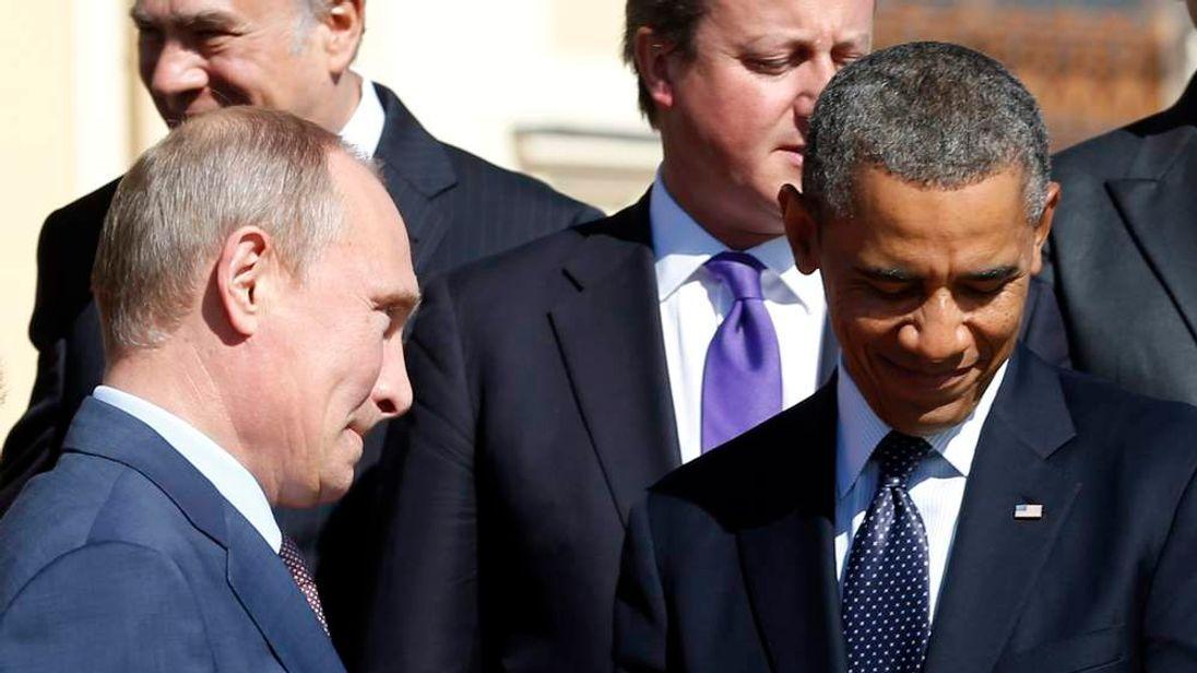 Putin walks past Obama at the G20 in St Petersburg