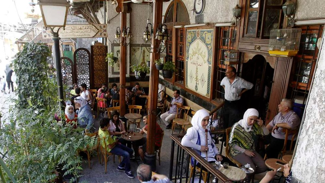 Syrians sit in a coffee shop in old Damascus