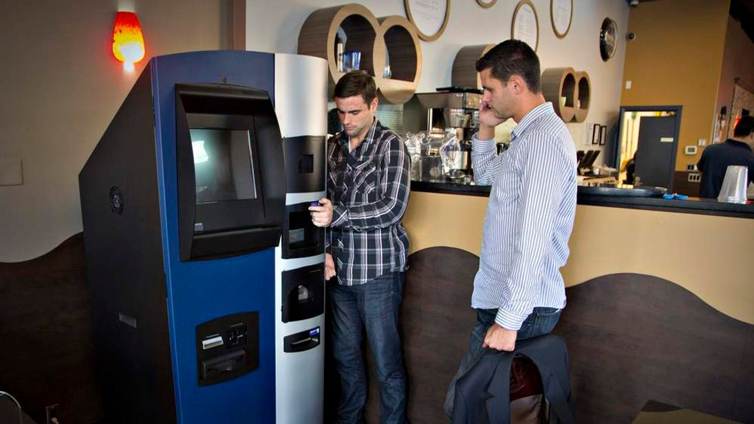 Mitchell Demeter and Jackson Hudson and the Bitcoin ATM in Vancouver, Canada
