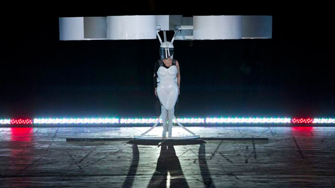 """Lady Gaga prepares to fly with the Volantis, a flying dress, at the """"artRave"""" release event of her new album """"ARTPOP"""" in New York"""