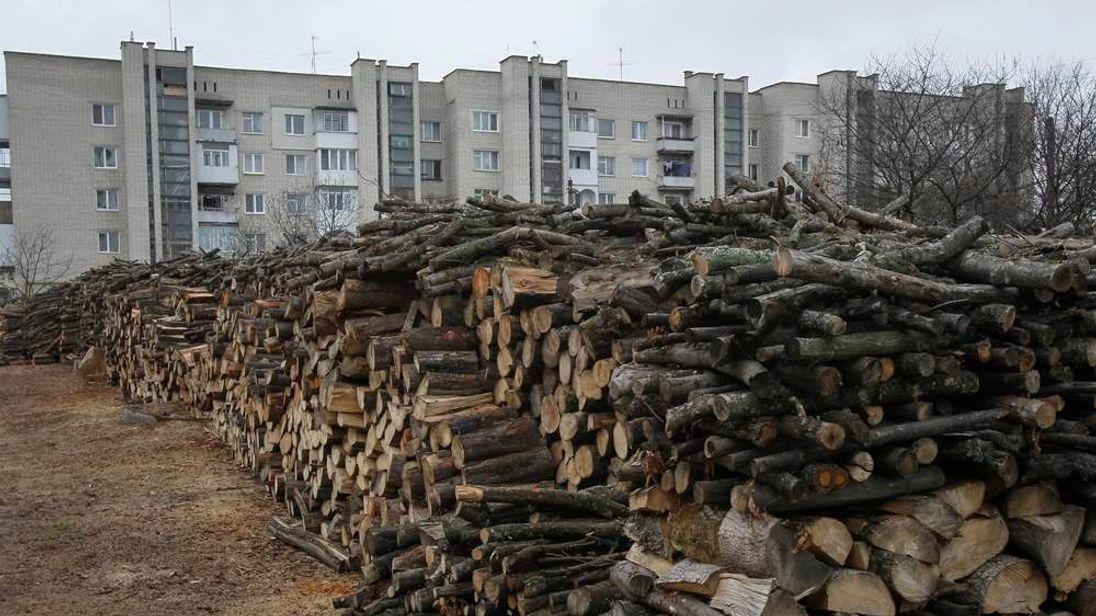 Wood is seen stacked in front of buildings in the western Ukrainian town of Zolochiv, in a boycott of Russia's Gazprom supplying energy