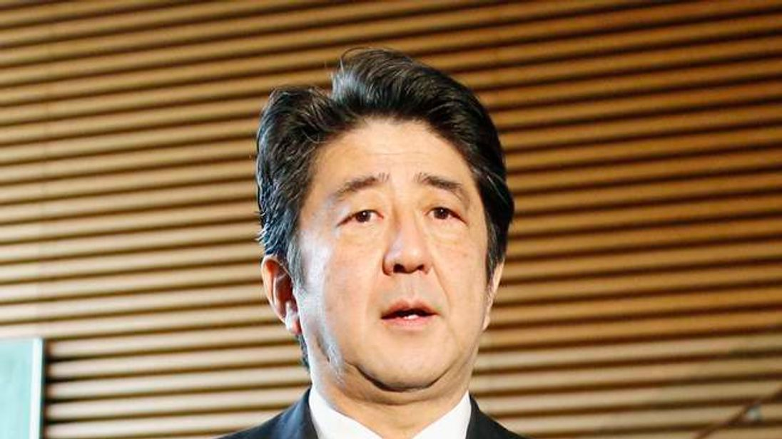 Japan's PM Abe speaks to the media regarding the death of former South African President Nelson Mandela at Abe's official residence in Tokyo