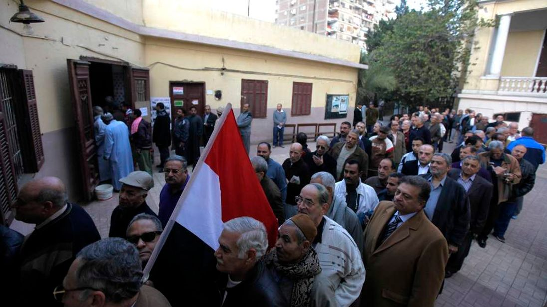 People queueing outside a polling station in Cairo, Egypt.