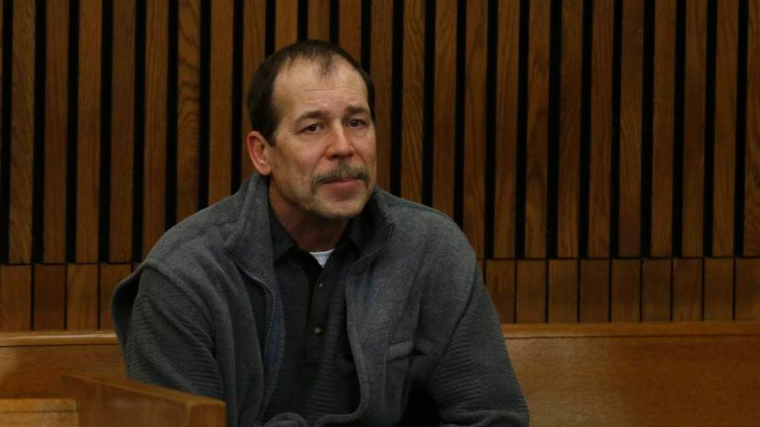Theodore Wafer sits in the back of the court room before his arraignment in Detroit, Michigan