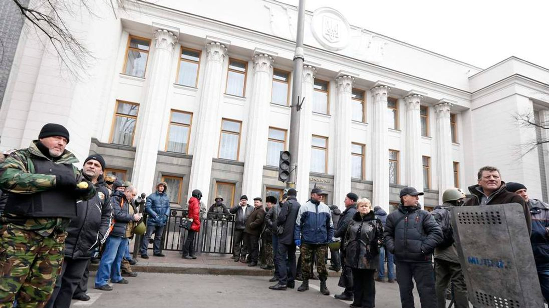 Anti-government protesters guard the entrance to the Ukrainian Parliament building in Kiev